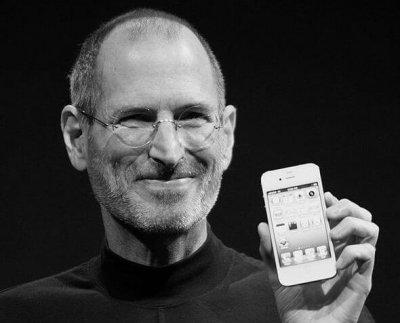 Steve Jobs holding Apple iphone